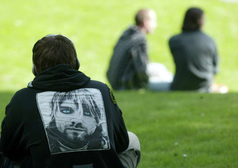 Justin Sevier wears a jacket with the image of Kurt Cobain on the back as his listens to Nirvana tune through headphones at Viretta Park April 5, 2004. That day marked 10 years since Cobain died. Photo: Mike Urban/Seattlepi.com File, SEATTLE POST-INTELLIGENCER