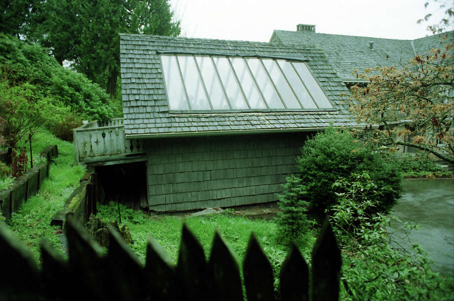 The greenhouse above the garage where Kurt Cobain's body was found was demolished in 1998, four years after his death. This image, which has not been previously published, was taken April 8, 1994, the day Cobain was found. Photo: Mike Urban/Copyright MOHAI, Seattle Post-Intelligencer Collection, 2000.107_19940408_0084.