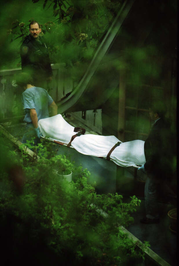 Kurt Cobain's body is removed from his home, April 8, 1994. This specific fame, taken by a P-I photographer that day, has not previously been published. Photo: Mike Urban/Copyright MOHAI, Seattle Post-Intelligencer Collection, 2000.107_19940408_0052.