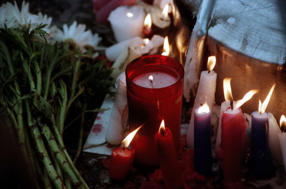 Some of the many candles at the public memorial for Kurt Cobain, which was held at Seattle Center. Photo: P-I Staff Photographer/Copyright MOHAI, Seattle Post-Intelligencer Collection, 2000.107_19940410_0050.