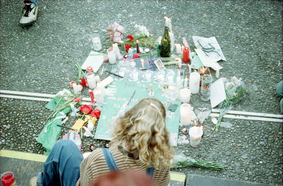 A mourner at the April 10, 1994, public memorial for Kurt Cobain at Seattle Center. This image, which is overexposed, has not previously been published. Photo: P-I Staff Photographer/Copyright MOHAI, Seattle Post-Intelligencer Collection, 2000.107_19940410_0060.