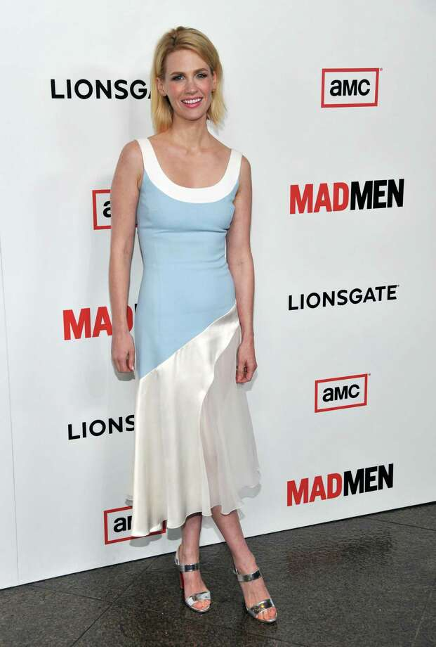 """FILE - In this Wed., March 20, 2013 file photo, January Jones, a cast member in """"Mad Men,"""" poses at the season six premiere of the drama series at the Directors Guild of America, in Los Angeles. Jones, known for her daring red carpet looks, has topped many a best and worst-dressed list. The 35-year-old Hollywood mom says she could care less about what critics think of her style. (Photo by Chris Pizzello/Invision/AP, File) Photo: Chris Pizzello"""
