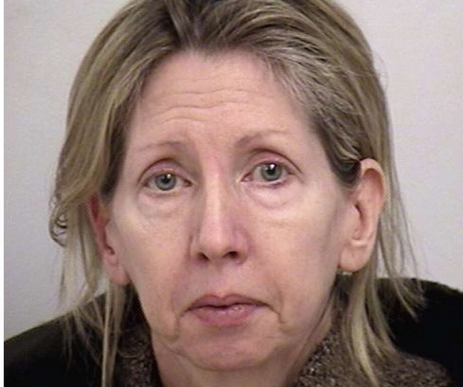 Lynn Marie Scalafani of West Parish Road has been charged with acquiring more than $30,000 in home furnishings and artwork by writing bad checks to local businesses. WESTPORT NEWS, CT 4/5/13 Photo: Westport Police Department / Westport News contributed