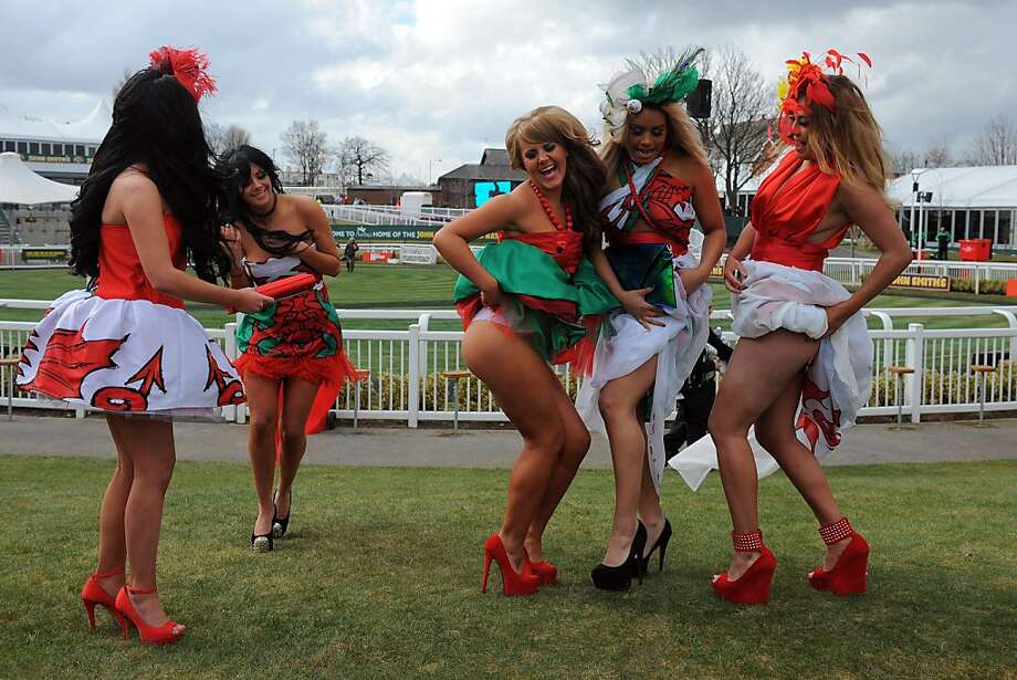 What happens at Aintree Racecourse, stays at Aintree Racecourse: On Ladies Day at the Grand National Meeting in Liverpool, women turn out in their highest heels, their most outrageous hats and their finest skirts and proceed to … hike the latter over their hips? Photo: Andrew Yates, AFP/Getty Images