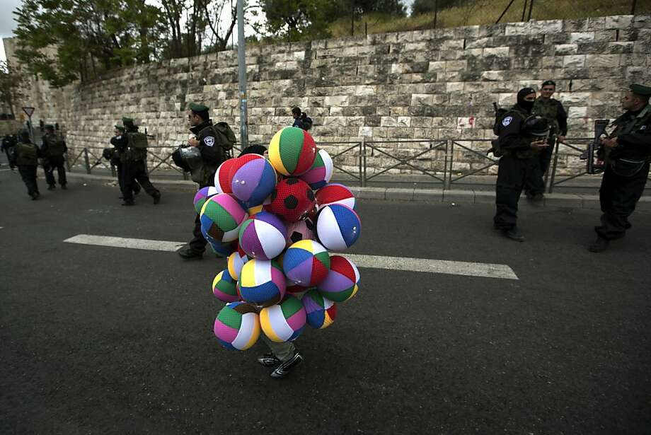 Nope, nothing suspicious about this:Israeli border guards ignore an ambulatory stack of beach balls at a checkpoint in Jerusalem's Old City. Photo: Menahem Kahana, AFP/Getty Images