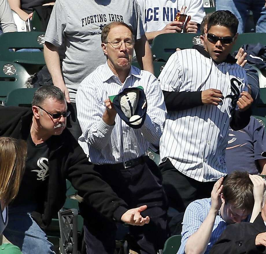 Tip your hat to this guy:Giants announcer Mike Krukow says you should always bring a glove to the ballpark. But if you forget, a cap will do in a pinch, as this White Sox fan demonstrates in Chicago. Photo: Charles Rex Arbogast, Associated Press