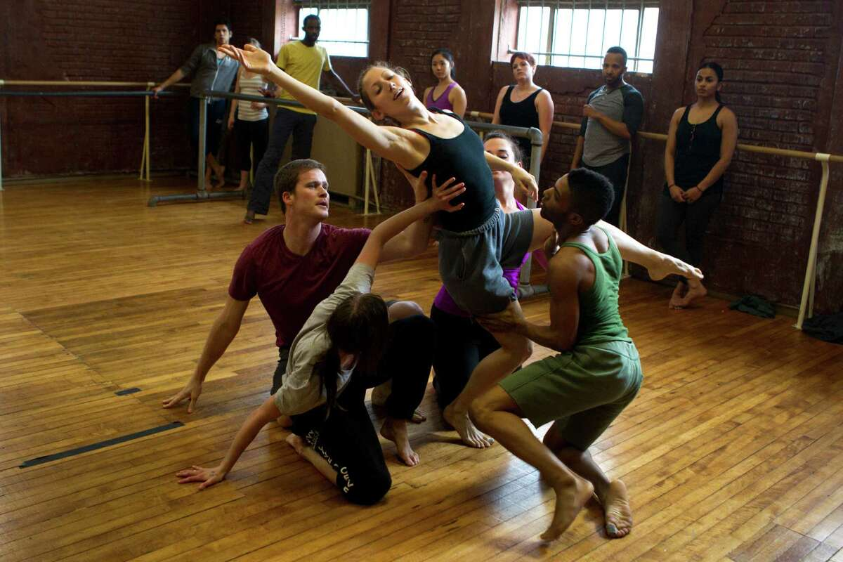 """Houston Metropolitan Dance Company practice moves for """"The Vessel,"""" a new work by choreographer Kiki Lucas."""