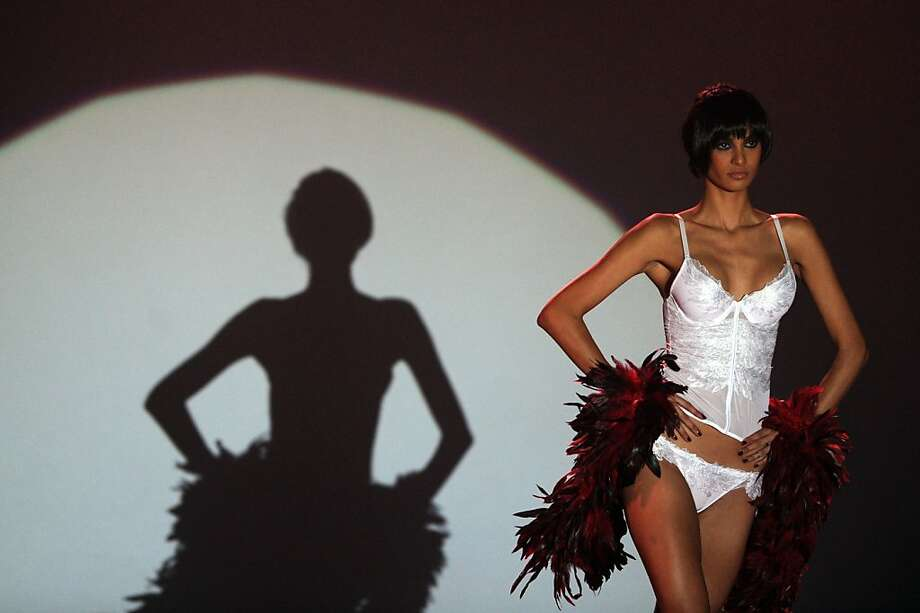 Local lingerie in the limelight:A spot shines on a model showing a creation by designer Avirate at Colombo Fashion Week. Garments are crucial to Sri Lanka's exports, accounting for more than 50 percent of the country's revenue. Photo: Ishara S.Kodikara, AFP/Getty Images
