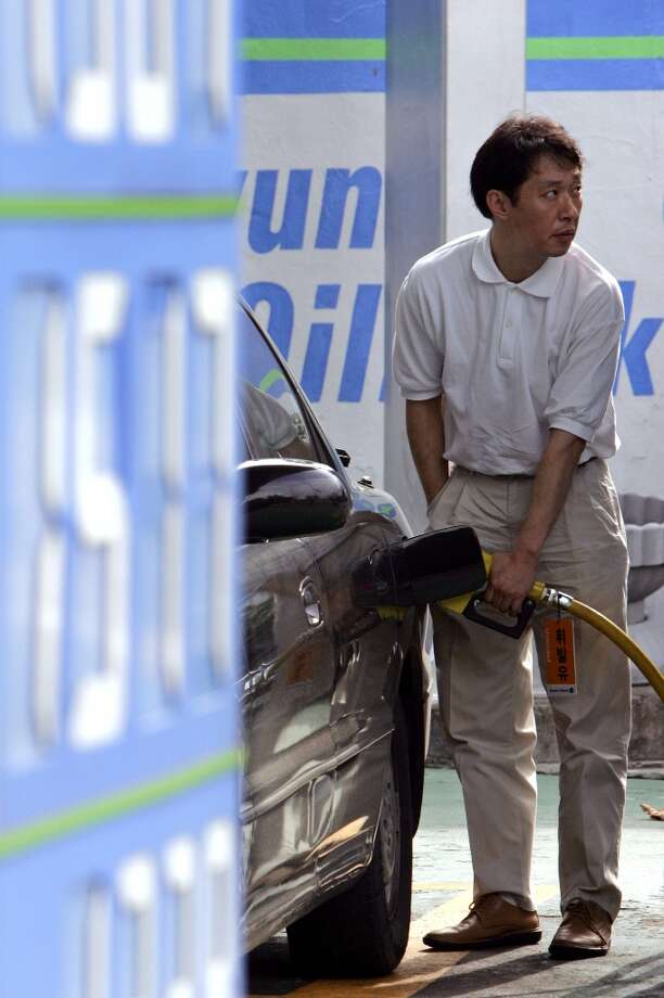 2. South Korea  Foreign workers: 2014 -- $156,500 2013 -- $141,800   Local workers: 2014 -- $70,000 2013 -- $81,400  [Photo: A driver fills his car at a service station in Seoul in 2005.] Photo: Lee Jae-Won, REUTERS / X01385