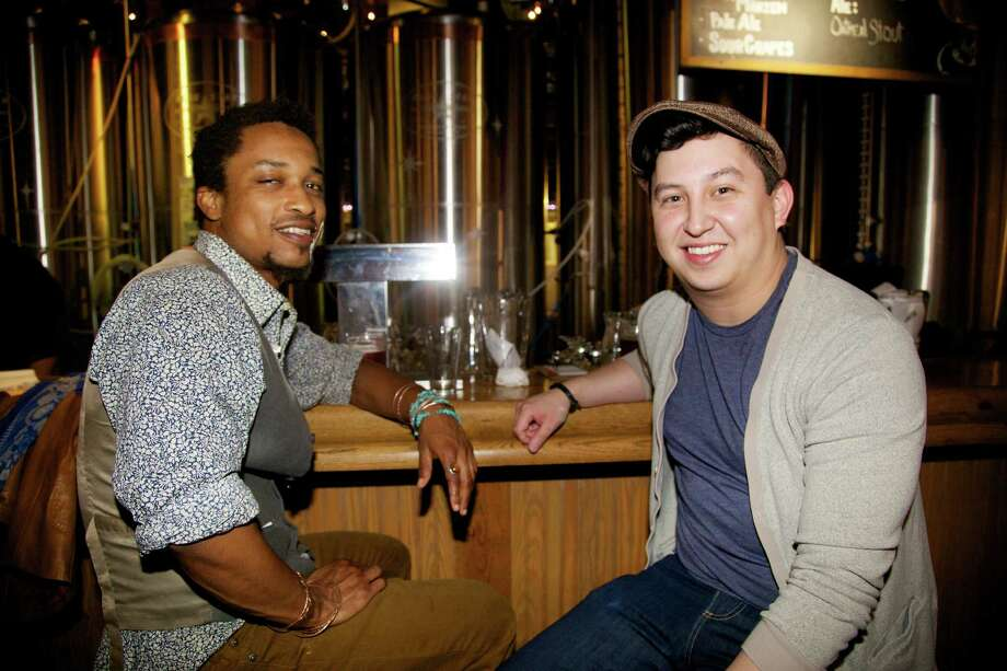 Michael Hall and Alex Arredondo are hanging out at the bar at Blue Star Brewing Company.