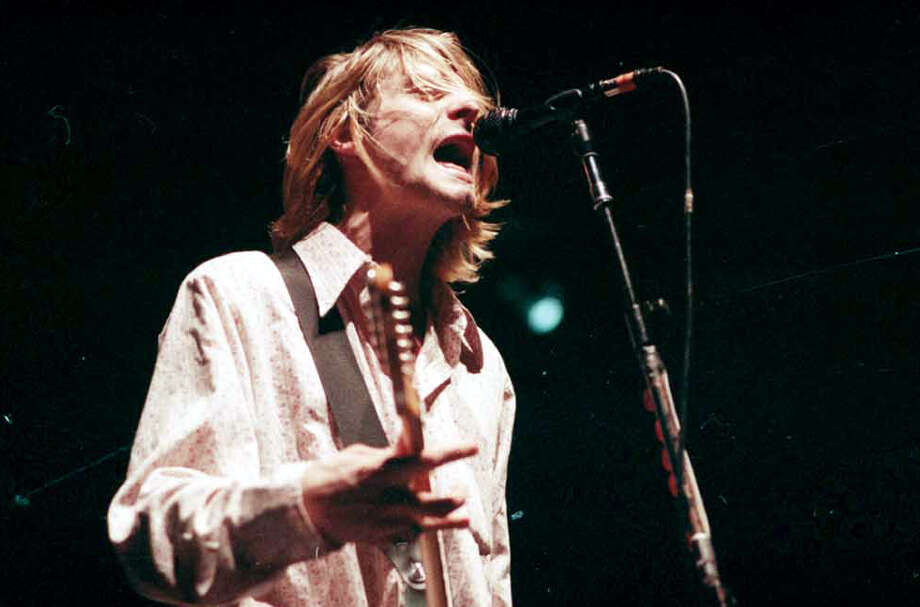 Twenty years after Kurt Cobain killed himself this month, Nirvana will be inducted into the Rock and Roll Hall of Fame on April 10, 2014. This photo is from Nirvana's last performance in Seattle, during the band's In Utero show at Seattle Center Arena on Jan. 7, 1994. Photo: Kurt Smith/CopyrightMOHAI, Seattle Post-Intelligencer Collection, 2000.107_negsBox4-19940107-roll 2-frame 8.