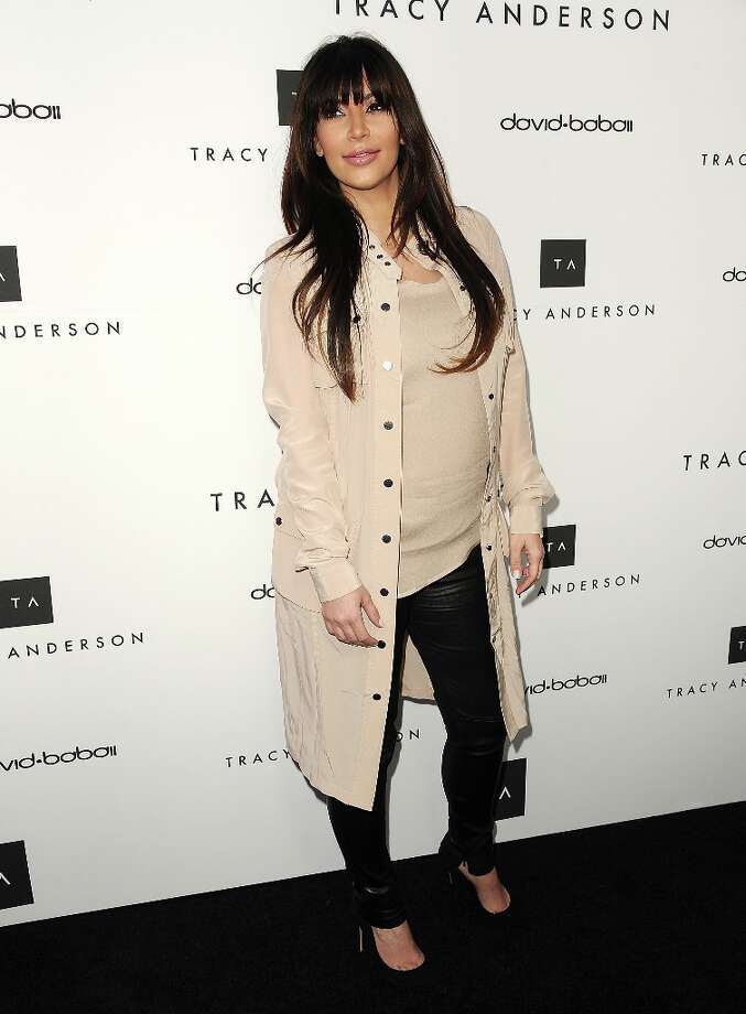 Kim Kardashian attends the opening of Tracy Anderson Flagship Studio on April 4, 2013 in Brentwood, California. Photo: Jason LaVeris, FilmMagic / 2013 Jason LaVeris