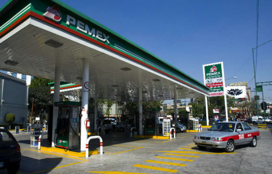 8. Mexico  Foreign workers: 2014 -- $132,700 2013 -- $132,300  Local workers: 2014 -- $79,600 2013 -- $50,000  [Photo:  A taxi enters a Pemex gasoline station in Mexico City in 2008.] Photo: Omar Torres, AFP/Getty Images