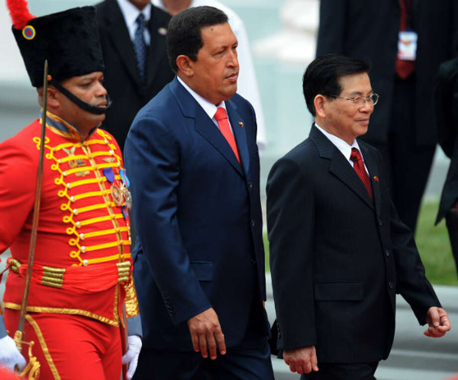 5. Vietnam  Foreign workers: 2014 -- $142,200 2013 -- $132,700   Local workers: 2014 -- $26,600 2013 -- $53,300  [Photo: Former Vietnamese President Nguyen Minh Triet (right) and his then-counterpart Venezuelan President Hugo Chavez (center) walk during the welcoming ceremony at the Venezuelan presidential palace Miraflores, in Caracas in 2008. During the first visit by a head of state from Vietnam to Venezuela, Triet was expected to sign oil and gas deals with Chavez and conduct other business.] Photo: Juan Barreto, AFP/Getty Images