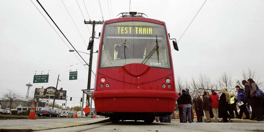 Streetcars bring much more than mere transportation to the city's downtown area. Photo: File Photo, Associated Press