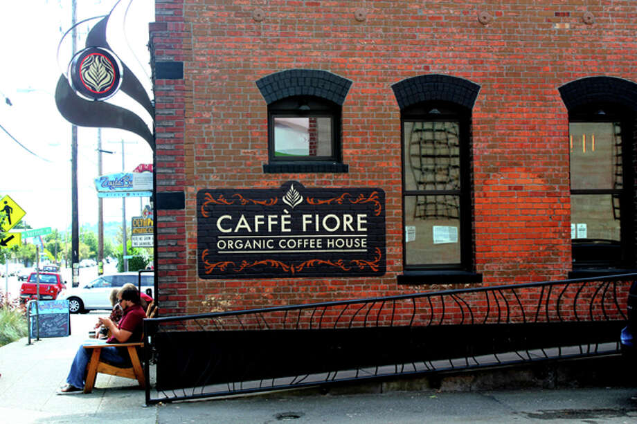 Caffe Fiore has locations in Queen Anne, Ballard, Sunset Hill and West Seattle. The shop in Ballard is a cozy brick nook on Leary Avenue glowing with hanging golden lights.  Location pictured: 5405 Leary Ave. N.W. Photo: Rachel Reed, SEATTLEPI.COM