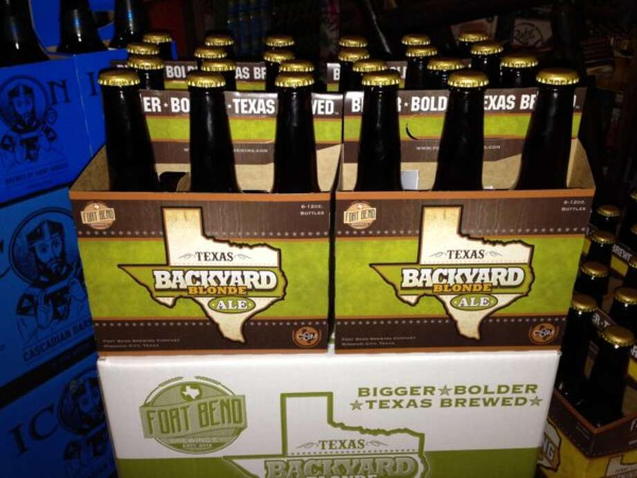 Fort Bend Brewing\'s Backyard Blonde, shown here in new six-packs, will be available on draft at Constellation Field in Sugar Land during Skeeters minor-league baseball games. Find the blonde and Farmhouse Ale on tap beginning Opening Day on April 18.