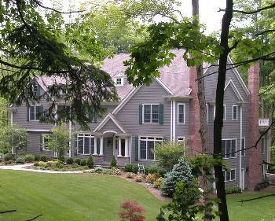 Ridgefield:This home on Old Branchville Road in Ridgefield was reduced by $55,000 for a new price of $1,395,000.