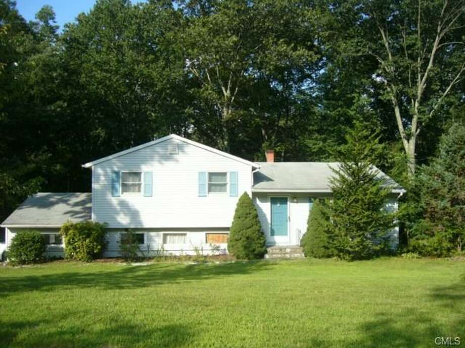 Monroe: This home at 2 Chalk Hill Road in Monroe was reduced by $20,000 on April 3, for a new sale price of $260,000.