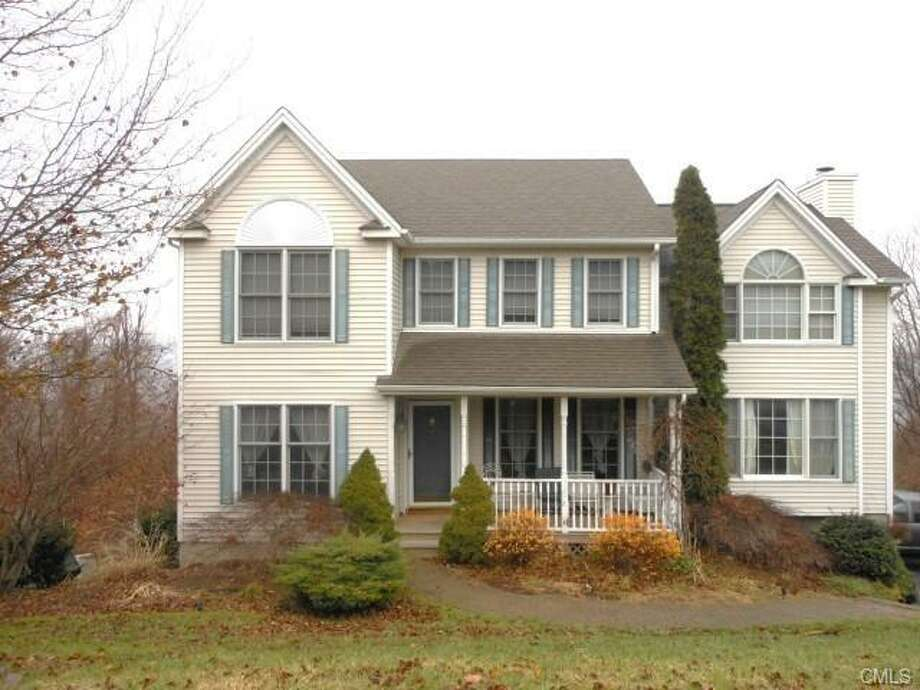 New Milford: This home at 11 Reynolds Farm Road in New Milford was reduced by $15,00 on April 4, for a new sale price of $284,000.