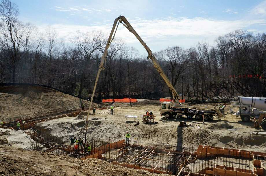 Concrete was poured for the first time Friday into the foundation of the Westport Weston Family Y's complex under construction at its Mahackeno property in northwest Westport. Friday, April 5, 2013 Photo: Paul Schott / Westport News