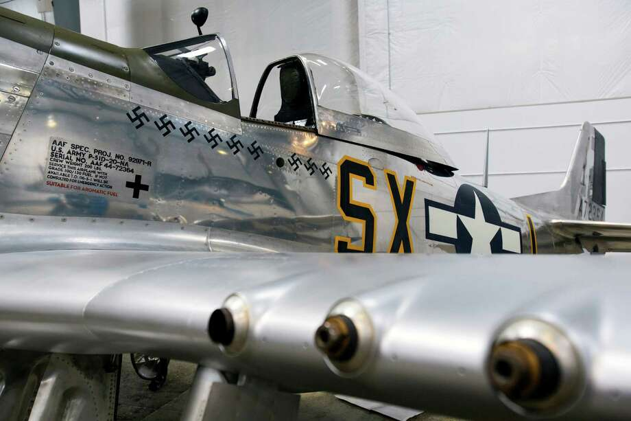 A North American P51-D Mustang sits on display during a preview of the new Hangar 2 Friday, April 5, 2013, at the Flying Heritage Collection in Everett. Hangar 2, a 26,000-square-foot expansion to the museum, is set to open to the public on Friday, April 12. The Flying Heritage Collection is Paul G. Allen's collection of rare military aircraft and land units, comprised of examples from Germany, Japan, Russia, the United Kingdom and the United States. Photo: JORDAN STEAD / SEATTLEPI.COM