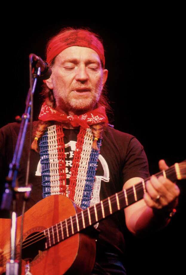 Red, white and Willie: Always a good source for bandanas, Nelson performs on stage in New York, 1979. Photo: Michael Putland, Getty Images / 1979 Michael Putland