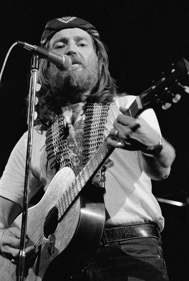 Iconic Willie: With the bushy beard, the long hair and the red, white and blue guitar strap, Nelson performs at Hammersmith Odeon, London, circa 1977. Photo: Terry Lott, Getty Images / Sony Music Archive