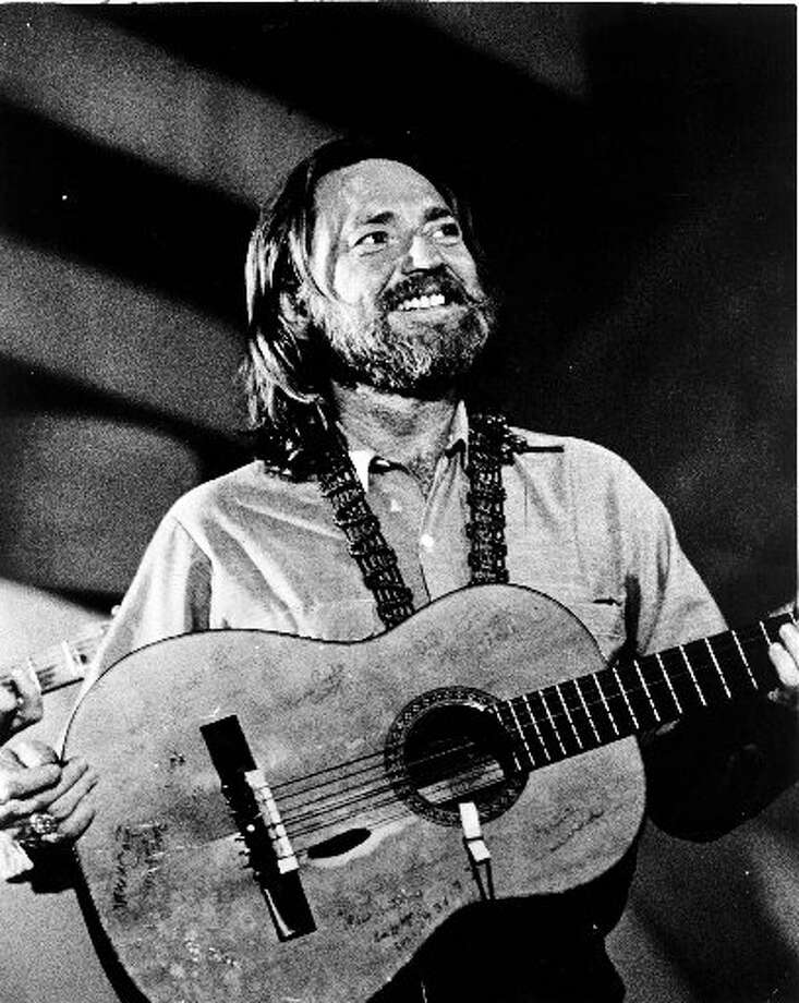 Smiling Willie: The singer and his guitar, Trigger, in the late '70s. Photo: Getty Images