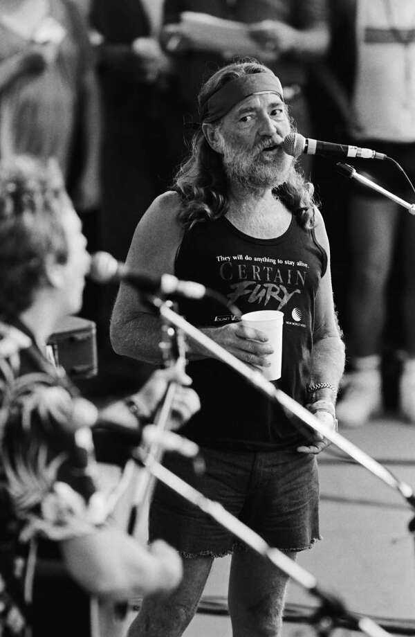 Lend-a-hand Willie: Nelson performs at the 1986 Manor Farm Aid II concert north of Austin. Photo: George Rose, Getty Images / 1986 George Rose
