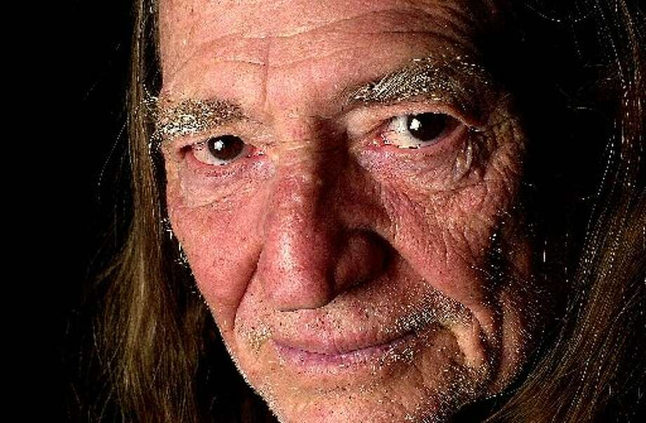 "Close-up Willie: A fairly clean-shaven Nelson poses for a photo in New York in 2002 tied to the release of ""Crazy: The Demo Sessions,"" which compiled some of his earliest recordings. Photo: Getty Images"