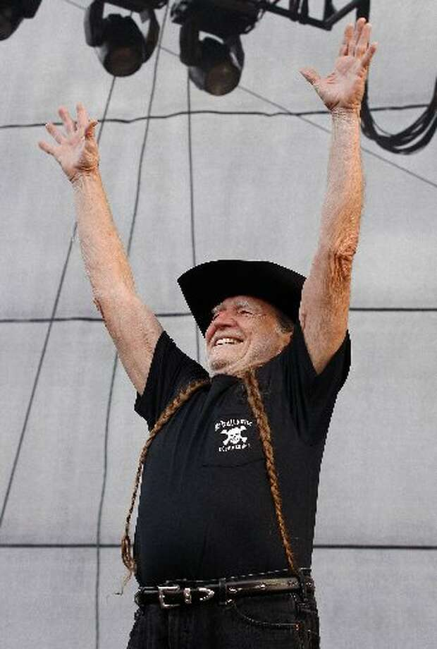 Touchdown Willie: Nelson signals a score at Bonnaroo in 2008. Photo: Getty Images
