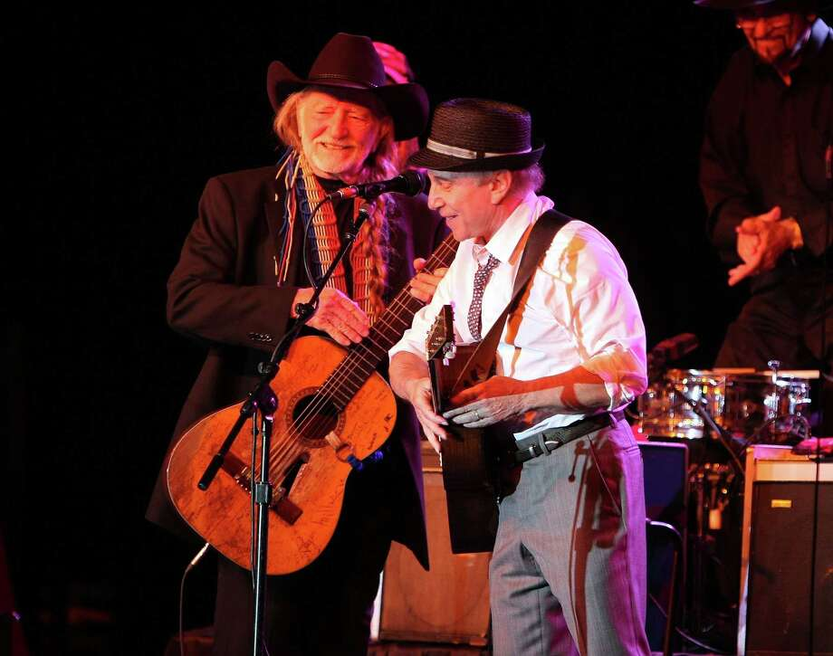 American tune Willie: Nelson and Paul Simon at the Children's Health Fund benefit in New York City, May 2009. Photo: Andrew H. Walker, Getty Images / 2009 Getty Images