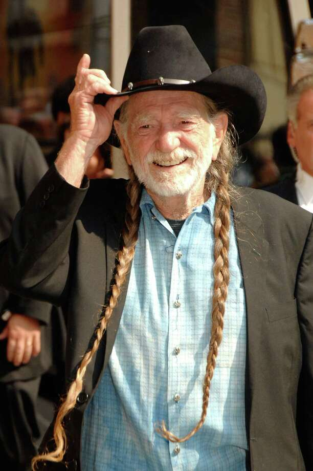 "Late night Willie: Nelson visits ""The Late Show With David Letterman"" at the Ed Sullivan Theater in New York in August 2007. Photo: Ray Tamarra, Getty Images / 2007 Ray Tamarra"