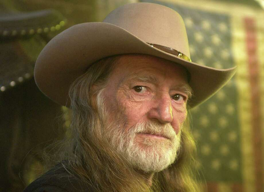 Willie Nelson at the Red Rock West Saloon in New York City, New York, likely in the late 1980s. Photo: Kevin Mazur, Getty Images / WireImage