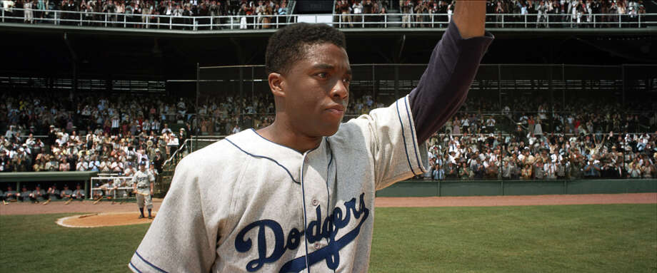 CHADWICK BOSEMAN as Jackie Robinson in Warner Bros. PicturesâÄô and Legendary PicturesâÄô drama âÄú42,âÄù a Warner Bros. Pictures release. Photo: Courtesy Of Warner Bros. Picture