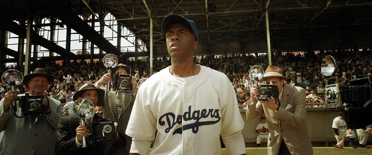 "Chadwick Boseman stars in ""42"" as the Brooklyn Dodgers' legendary baseball player, Jackie Robinson."