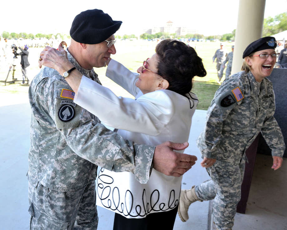 Outgoing and retiring Commander of the Army Medical Department Center and School Maj. Gen. Philip Volpe (left) is hugged by his mother, Dorothy Volpe of Long Island, N.Y., as Lt. Gen. Patricia D. Horoho walks away following the Relinquishment of Command Ceremony at Ft. Sam Houston Friday April 5, 2013 Photo: Robin Jerstad