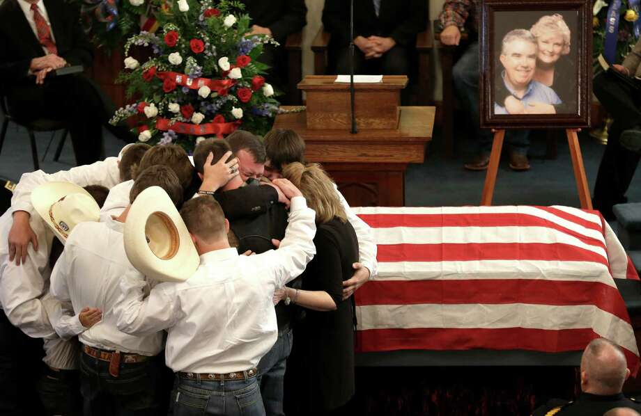 The family of Kaufman County District Attorney Mike McLelland and his wife, Cynthia, comfort each other during their funeral services at  the First Baptist Church of Wortham Friday, April 5, 2013, in Wortham, Texas.  The couple was found shot to death Saturday in their house near Forney, about 20 miles east of Dallas. No arrests have been made. Photo: LM Otero, Associated Press / AP
