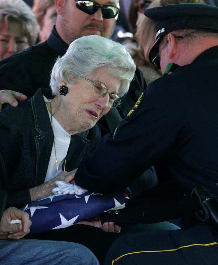 Wyvonne McLelland, mother of  Kaufman County District Attorney Mike McLelland receives a flag from Nathan Foreman, during the grave side funeral services for the couple in Wortham, Texas, Friday, April 5, 2013.  T Photo: LM Otero, Associated Press / AP