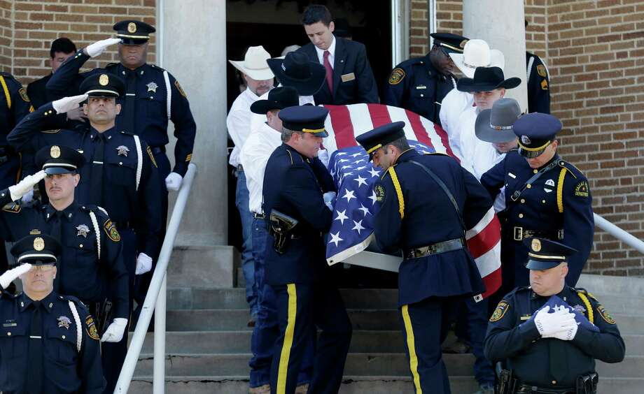 Pallbearers carry the remains of Kaufman County District Attorney Mike McLelland and his wife, Cynthia, out of the First Baptist Church of Wortham after their funeral services Friday, April 5, 2013, in Wortham, Texas. Photo: LM Otero, Associated Press / AP