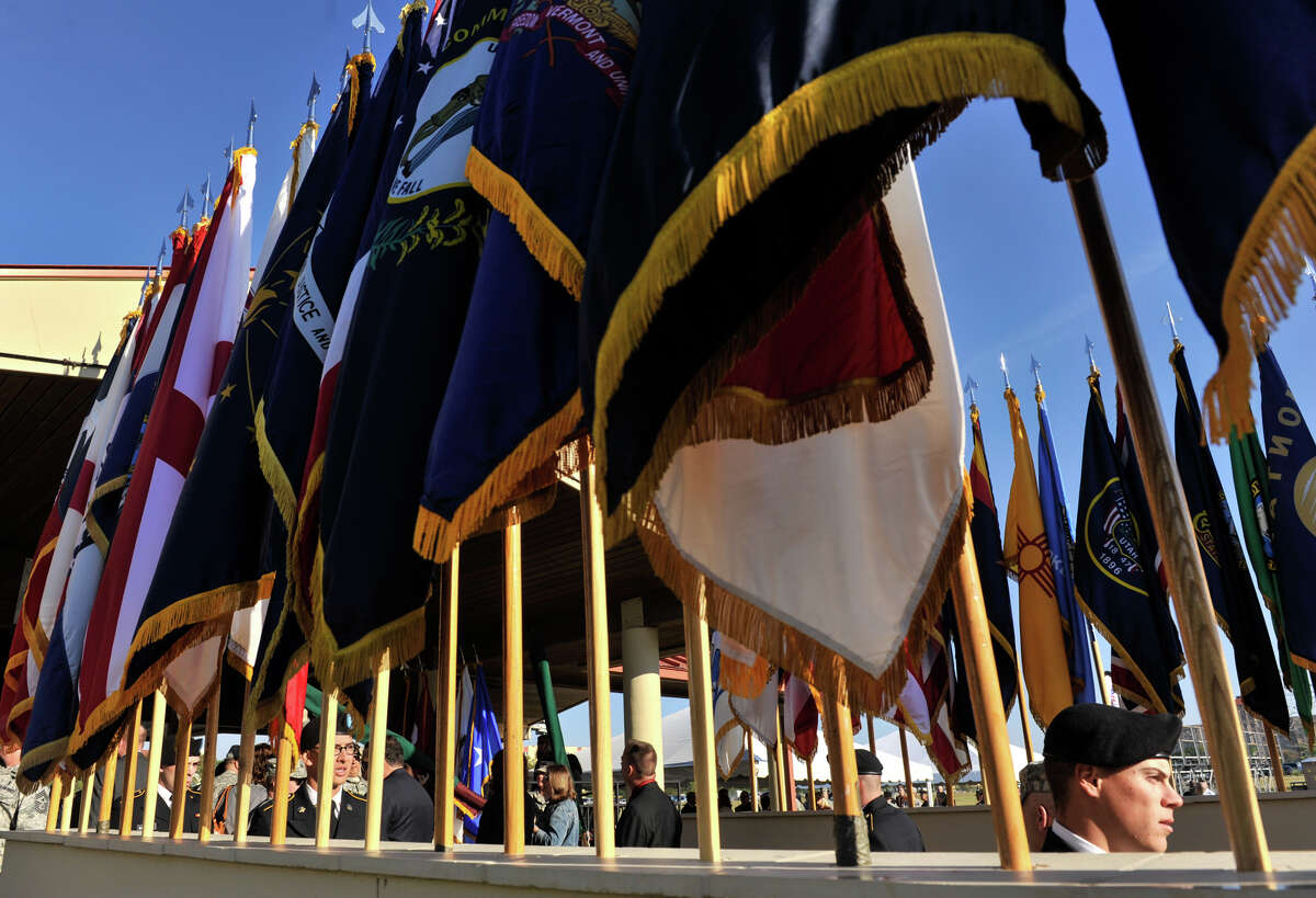 Guests enter the Relinquishment of Command Ceremony at Arthur MacArthur Parade Field at Fort Sam Houston on Friday.