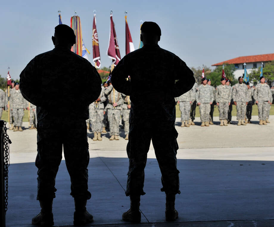 Outgoing and retiring Commander of the Army Medical Department Center and School MG Philip Volpe (left) and Incoming Commander Col. Randall G. Anderson watch as the colors are presented during the Relinquishment of Command Ceremony at Fort Sam Houston on Friday. Photo: Robin Jerstad