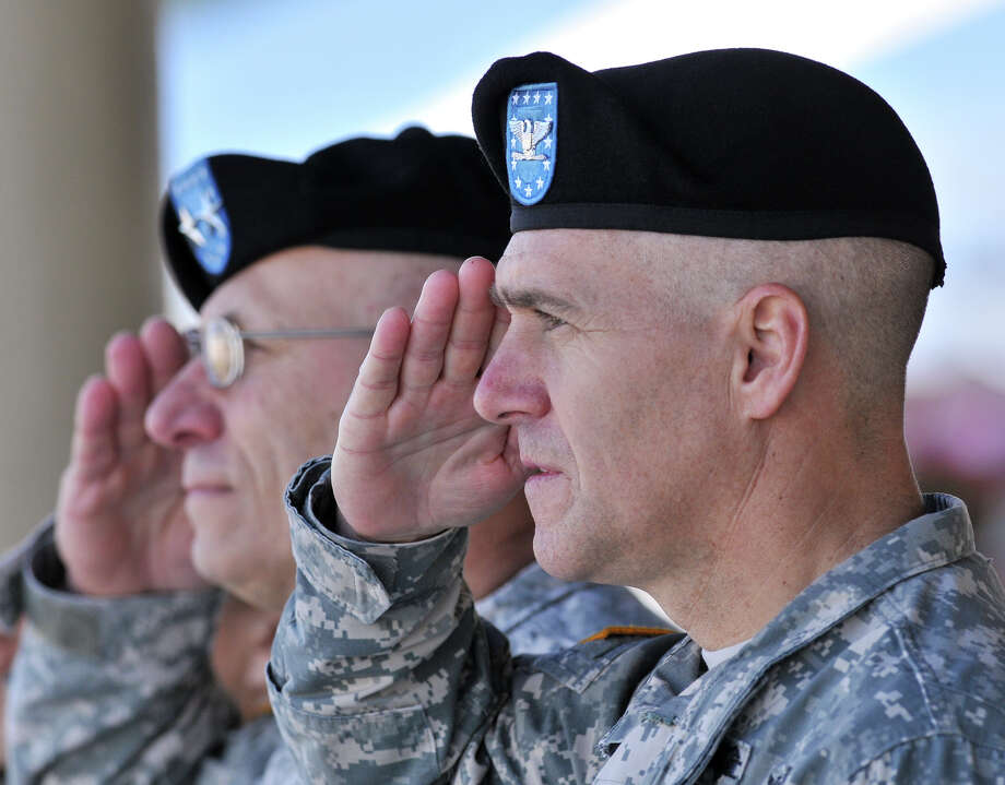 Incoming Commander of the Army Medical Department Center and School, Col. Randall G. Anderson, (right), and outgoing Commander MG Philip Volpe, salute during the Relinquishment of Command Ceremony at Fort Sam Houston's Arthur MacArthur Parade Field on Friday morning. Photo: Robin Jerstad