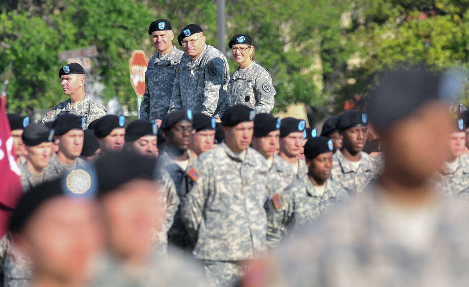 Incoming Commander of the Army Medical Department Center and School, Col. Randall G. Anderson, (second from left), Outgoing Commander MG Philip Volpe, (center), and The Surgeon General and Commander of the Army Medical Command, LTG Patricia D. Horoho inspect troops during the Relinquishment of Command Ceremony at Ft. Sam Houston's Arthur MacArthur Parade Field Friday morning. They were led by Commander of Troops, Col Jonathon Fristoe (left). Photo: Robin Jerstad