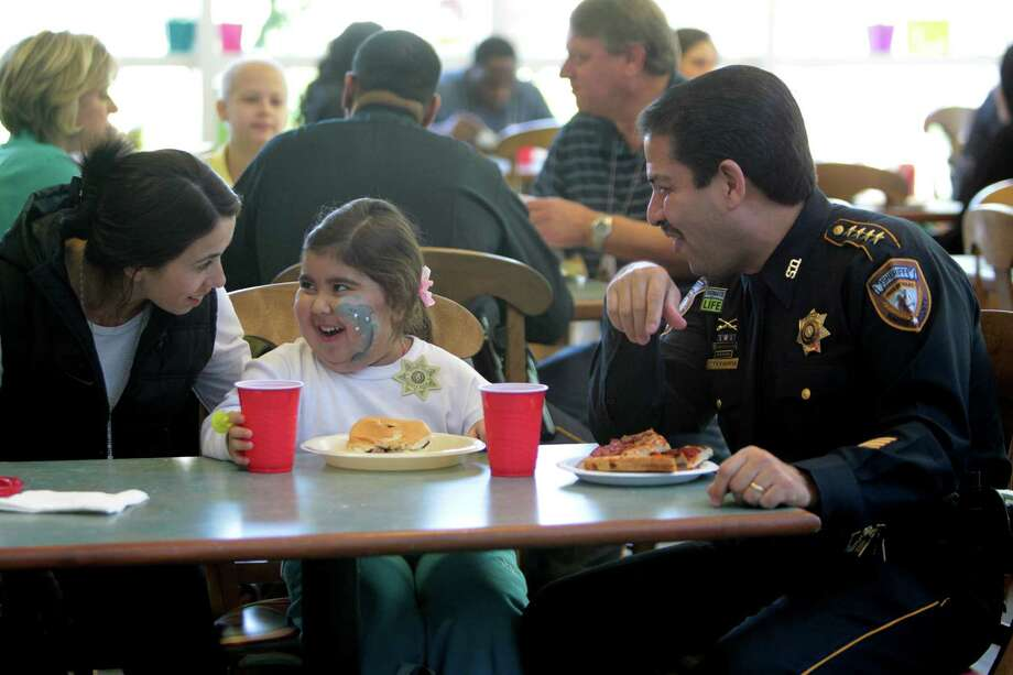 Sofia Flores, 5, of Argentina, laughs with her mother Zulma Roa and Harris County Sheriff Adrian Garcia at the Ronald McDonald House on Friday, April 5, 2013, in Houston. Photo: Mayra Beltran, Houston Chronicle / © 2013 Houston Chronicle