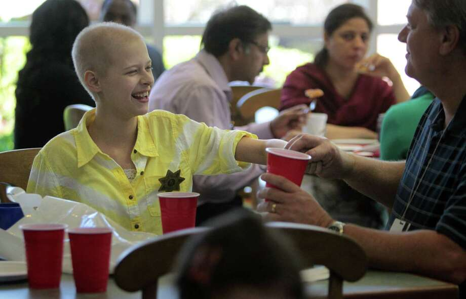 Andrea Timmons enjoys her lunch served by Harris County Sheriffs Office deputies at the Ronald McDonald House. Photo: Mayra Beltran, Houston Chronicle / © 2013 Houston Chronicle