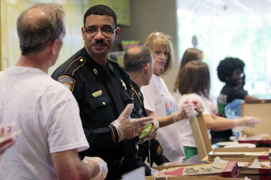 HCSO Sgt. Fred McGowen, a bone marrow donor, serves lunch to the children and families waiting for organ transplants and living at the Ronald McDonald House. Photo: Mayra Beltran, Houston Chronicle / © 2013 Houston Chronicle