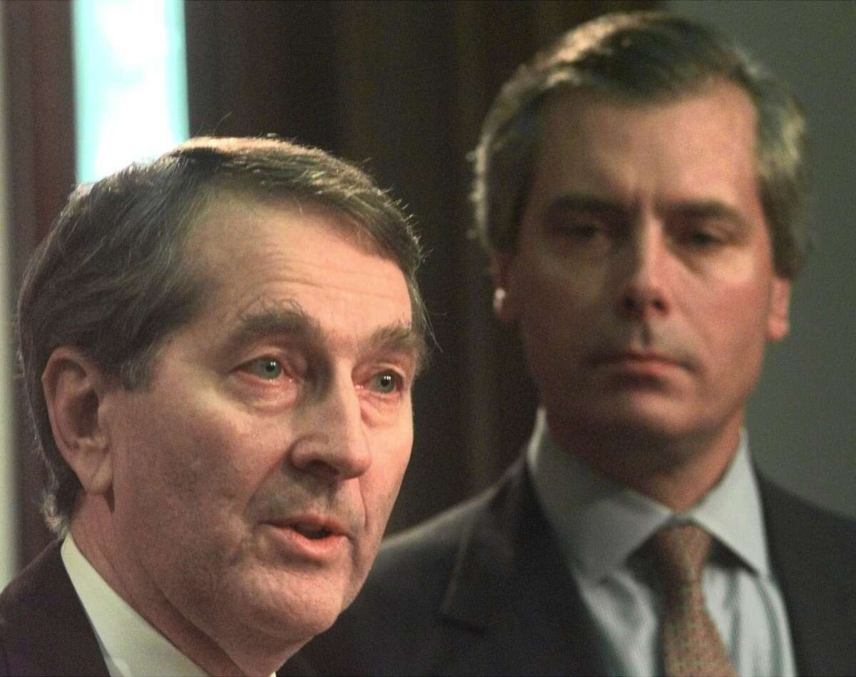Howard Wolf, left, speaks as Land Commissioner-elect David Dewhurst looks on at news conference at the state capitol in Austin, Texas, Wednesday, Nov. 4, 1998. Dewhurst introduced Wolf to lead his transitional team. (AP Photo/LM Otero)