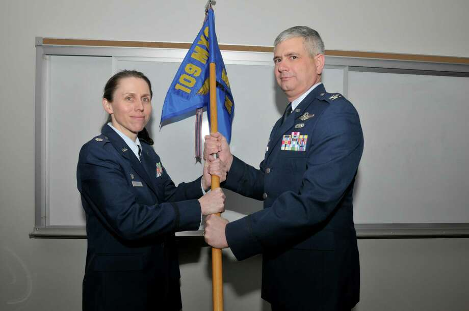 DIVISION OF MILITARY AND NAVAL AFFAIRS Air National Guard Lt. Col. Denise Donnell accepts the flag of the 109th Maintenance Group from 109th Airlift Wing Commander Col. Shawn Clouthier during a change of command ceremony.
